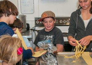 Image of making pasta at Tasty Reads dinner