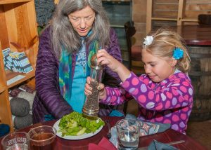 Image of adding pepper to a salad at Tasty Reads dinner